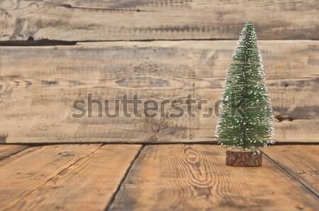 Little toy christmas tree on tinsel Stock photo © inxti