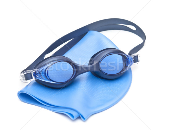 Blue swimming cap and goggles Stock photo © inxti