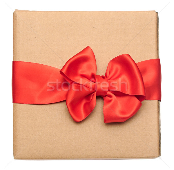 red ribbon bow over recycled nature paper cardboard. holidays ba Stock photo © inxti