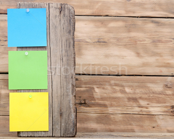 colorful reminder notes attached on a old wooden signpost Stock photo © inxti