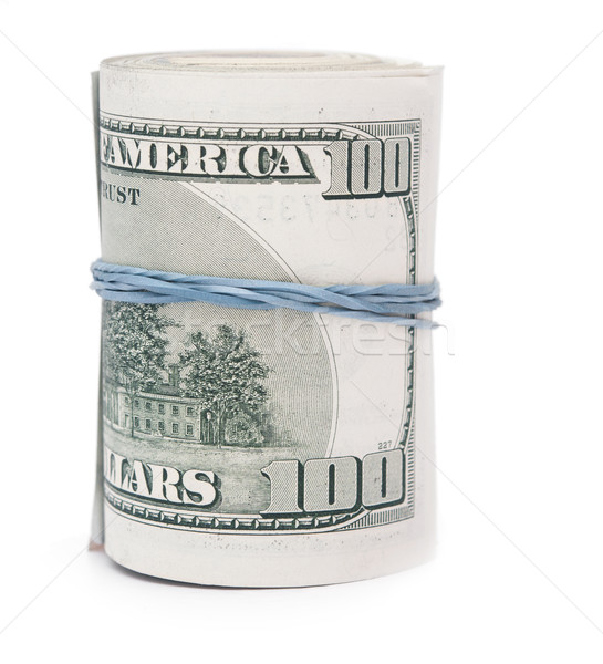 Hundred dollar bills rolled up with rubberband.  Stock photo © inxti