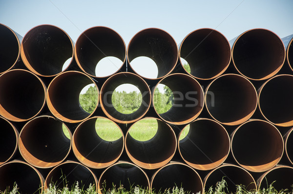 closeup of a pile of large and rusting steel pipes Stock photo © inxti