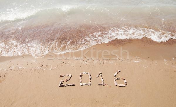 2016 written in sand on sunny beach Stock photo © inxti