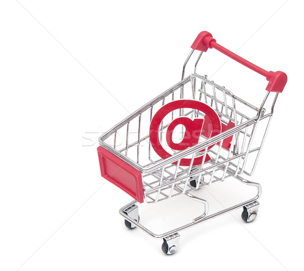 an at sign in a shopping cart, depicting the concept of e-shoppi Stock photo © inxti
