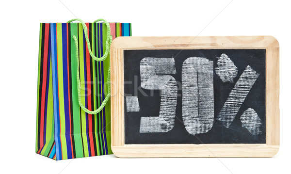 fifty percent written on blackboard with colorful shoping bag Stock photo © inxti