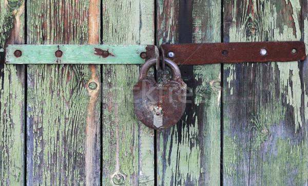 Old wooden doors locked with rusty padlock  Stock photo © inxti