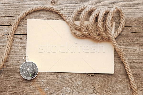 Stock photo: ropes and compass on old vintage ancient paper background textur