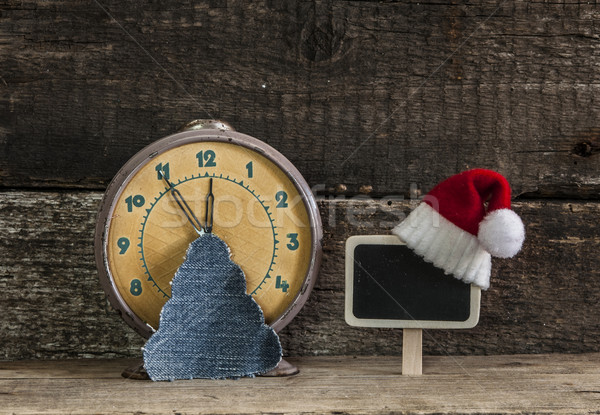 Christmas holiday background with Santa hat and decorations.  Stock photo © inxti