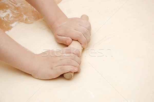 Child's hands kneading dough on wooden table Stock photo © inxti