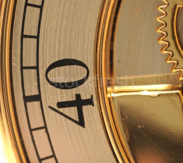 closeup golden clock with gears Stock photo © inxti