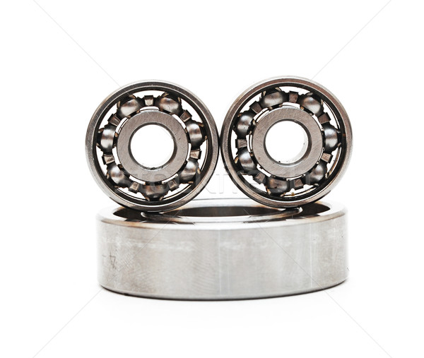 Big and small ball bearings on white background  Stock photo © inxti