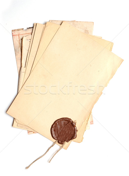 pile old paper with a wax seal on a white background  Stock photo © inxti