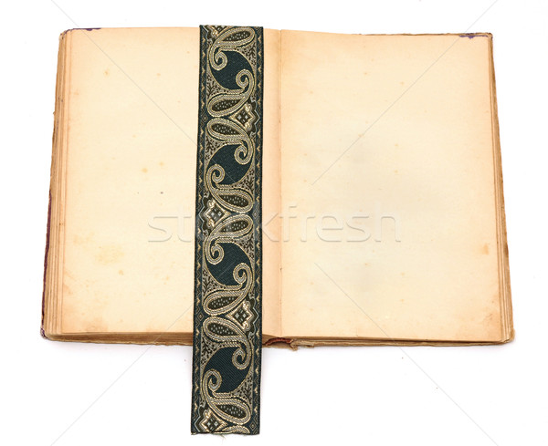blank open book with antique ribbon on white background Stock photo © inxti