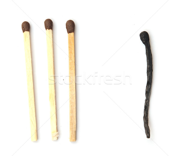 Close-up of a burnt match and a whole brown match isolated on a  Stock photo © inxti
