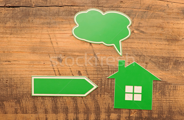 home icon with blank bubble speech and arrow over wooden backgro Stock photo © inxti