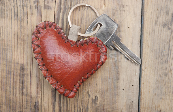 Key with leather trinket on wooden background Stock photo © inxti