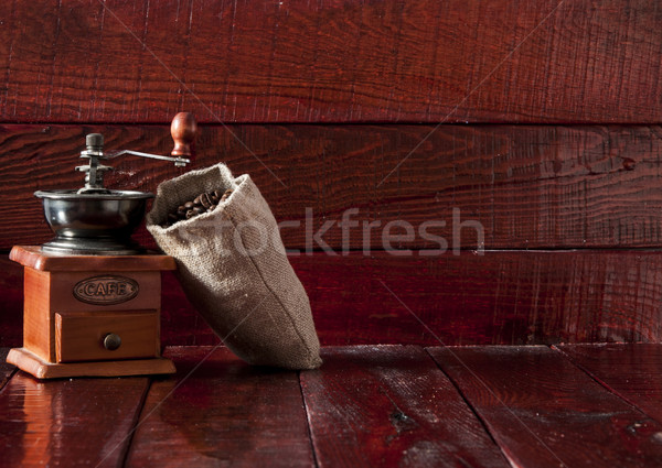 Stock photo: Coffee mill with burlap sack full of roasted coffee beans over w