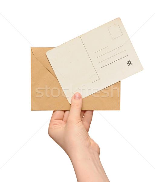 Sarı zarf bağbozumu boş kart el yalıtılmış Stok fotoğraf © inxti