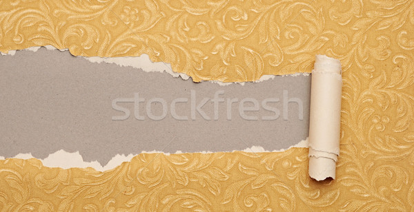Torn gold paper background with texture and copy space for your  Stock photo © inxti