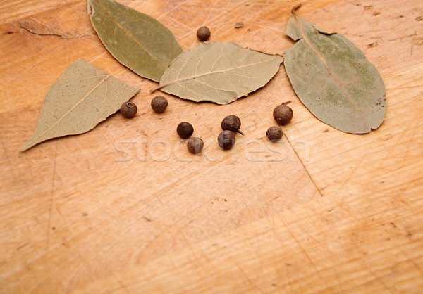 close up leafs of laurel and peppercorns on wood background Stock photo © inxti