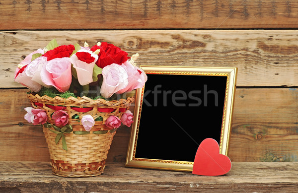 bouquet paper flower in a basket with blank photoframe Stock photo © inxti