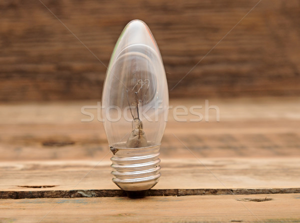 old burned out light bulb on wood background Stock photo © inxti