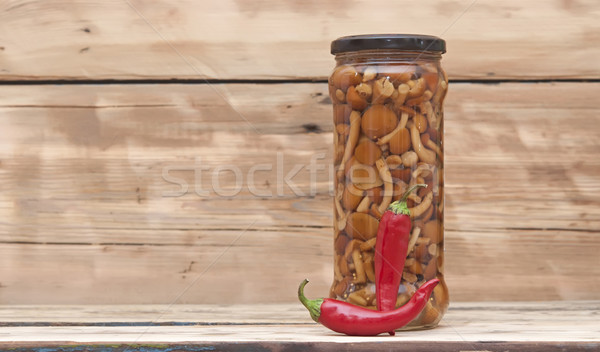 Mushrooms marinaded (agaric honey) in glass jar with red chili p Stock photo © inxti