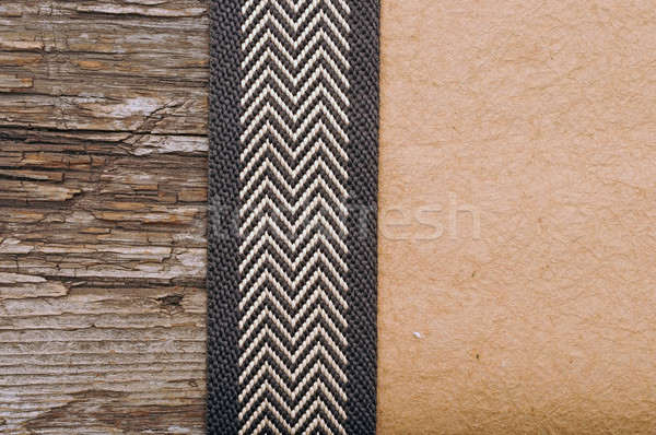 Wooden background with brown ribbon on brown crumpled paper  Stock photo © inxti
