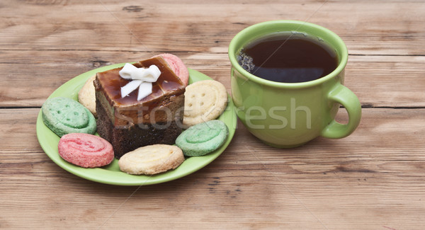 tea cup with colorful cookies, and  brown muffin on table Stock photo © inxti