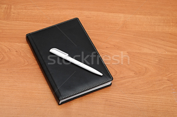 Black notepad and pen on table  Stock photo © inxti