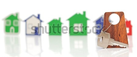 silver key with blank label shaped home. space for your text Stock photo © inxti