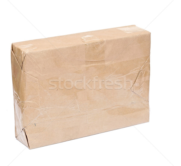 Parcel wrapped with brown packing paper isolated on white  Stock photo © inxti