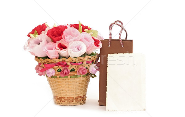 Paper flower in a basket with blank old photo frame Stock photo © inxti