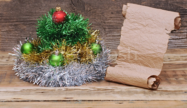 Christmas tree made of tinsel with old paper scroll Stock photo © inxti