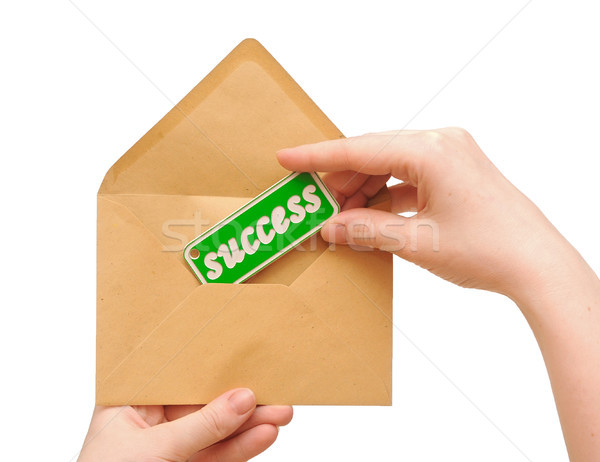 woman hand holding envelope mail with message of success Stock photo © inxti
