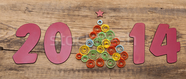 word 2014 and curling paper Christmas tree on wood background Stock photo © inxti