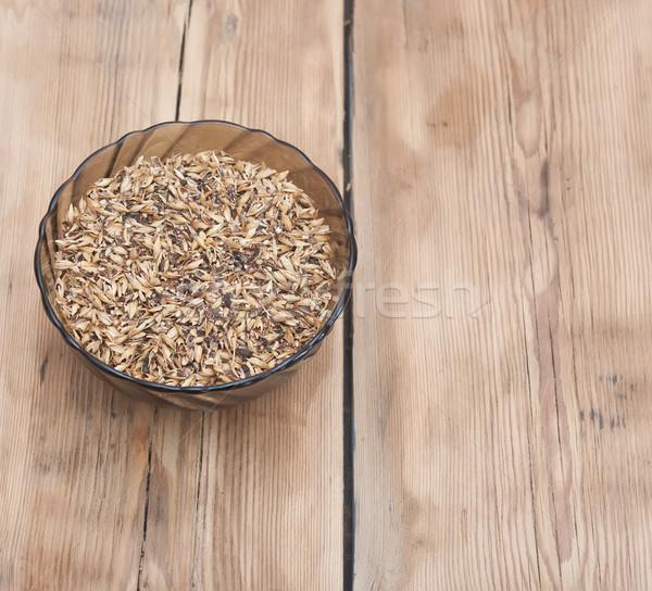Barley grains of malt in glass bowl Stock photo © inxti
