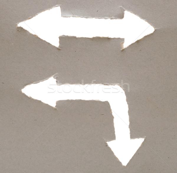 arrow cut into the cardboard Stock photo © inxti