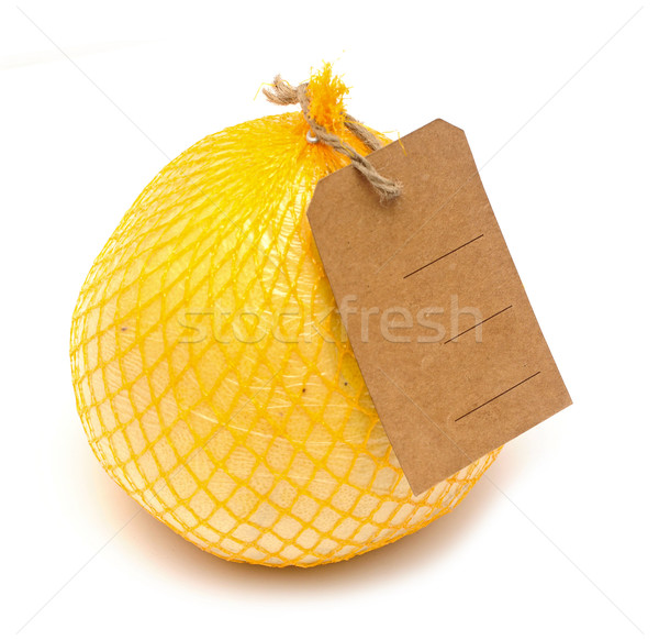 Pomelo fruit with blank price tag wrapped in a plastic Stock photo © inxti