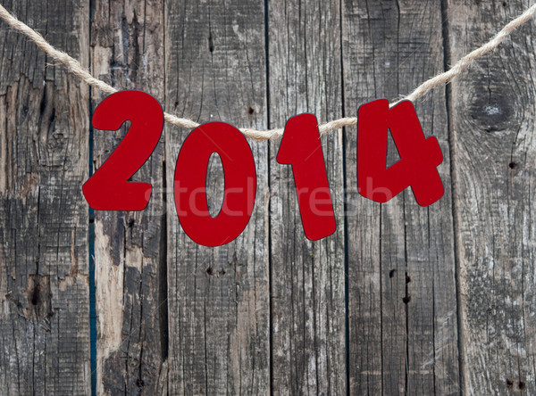 2014 New Year hanging rope on old wood background.  Stock photo © inxti