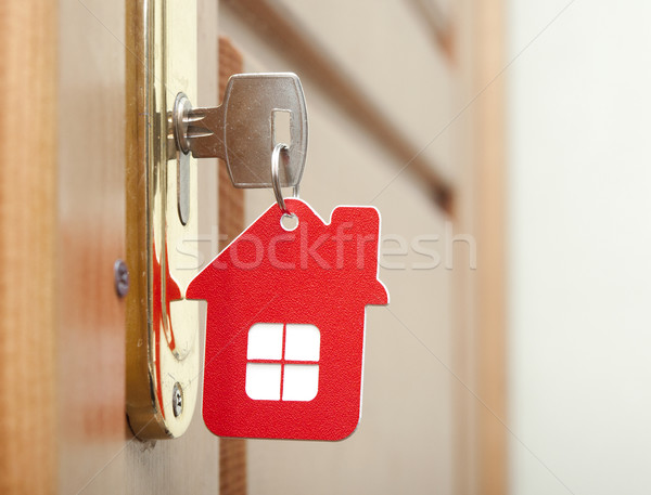 Stock photo: Symbol of the house and stick the key in the keyhole