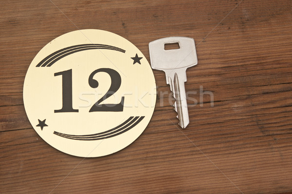 Hotel suite key with room number 12 on wood table  Stock photo © inxti