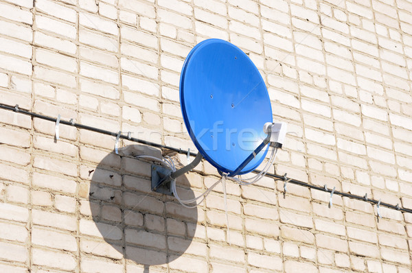 A satelite is attached to the wall  Stock photo © inxti