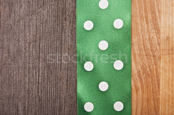 vintage wooden background with green polka-dot ribbon Stock photo © inxti