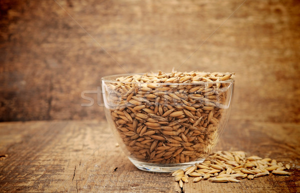 oats heaped in a glass cup on wooden table Stock photo © inxti