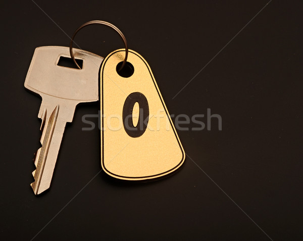 room key on black background with number 0 Stock photo © inxti