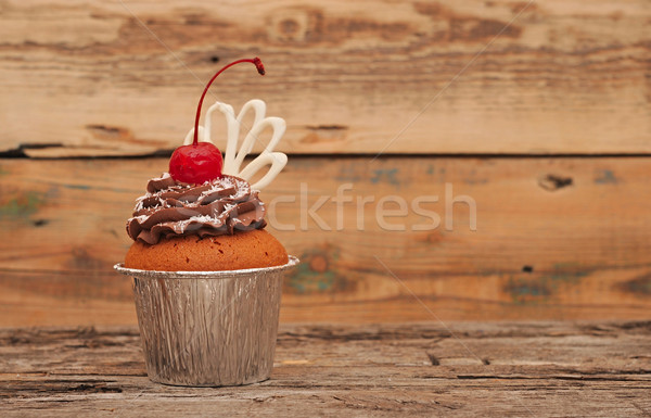 Chocolate cherry cupcakes on old wooden background Stock photo © inxti