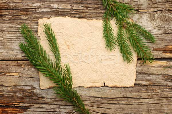 Christmas card: empty paper form with fir-tree branches on old w Stock photo © inxti