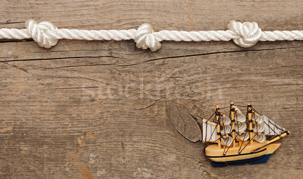 rope and model classic boat on wood background  Stock photo © inxti