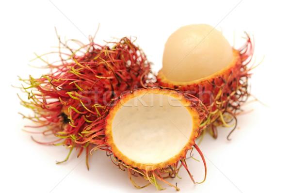 rambutan and one peel off rind Stock photo © inxti